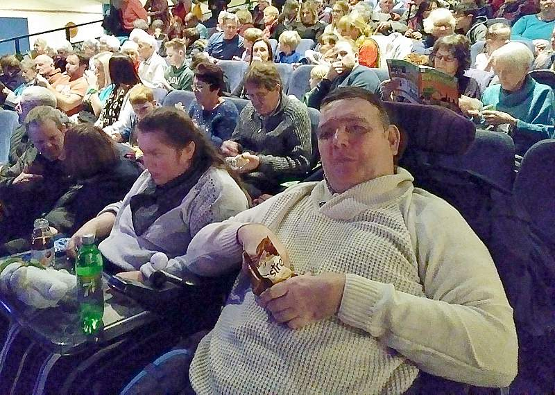 Photo of us enjoying a movie at one of our outings!
