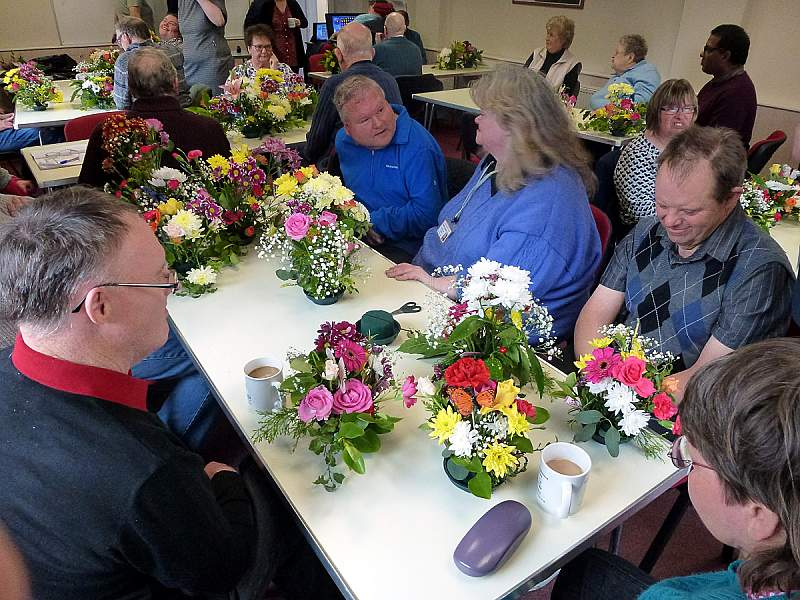 Photo of a member enjoying flower arranging!
